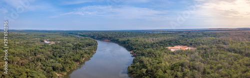 Beautiful panoramic aerial drone view of Rio Teles Pires and Amazon rainforest on sunny summer day with blue sky near Sinop city, Mato Grosso, Brazil Fototapeta