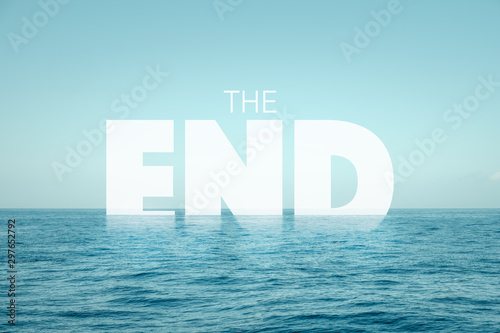 Cuadros en Lienzo  the end text in water with ocean background - climate change concept