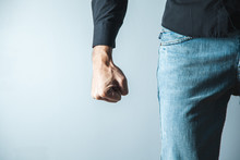 Angry Man Fist On Gray Wall Background