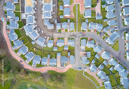 Suburban houses in row aerial view in summer illuminating gardens Wallpaper Mural
