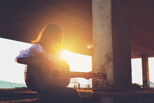 Candid Silhouette Woman Chill Play Acoustic Guitar Musician .Artists Female Sad Mood Activity Music