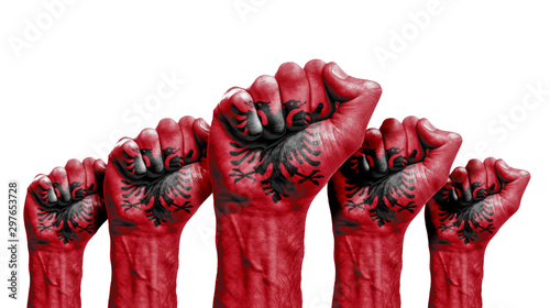 Photo A raised fist of a protesters painted with the albania flag