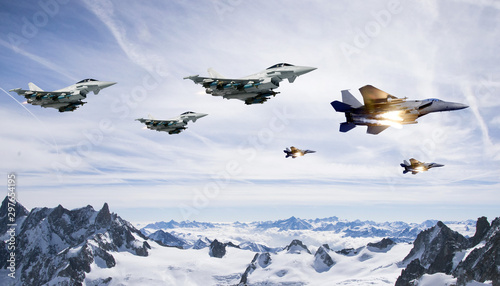 Photo fighter planes flying in high altitude clouds