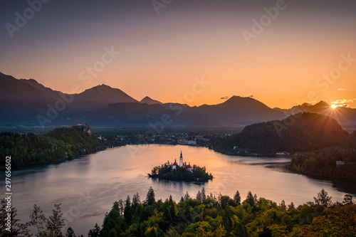 Foto auf Gartenposter Schokobraun Colorful landscape sunrise at Lake Bled with autumn foliage, Slovenia