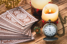 Tarot Cards And Old Pocket Watch On Brown Table Of Fortune Teller. Divination. Future Reading Time Concept.