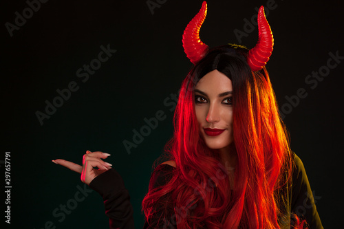 Image of Halloween makeup look of beautiful demon on dark background with copyspace Canvas-taulu