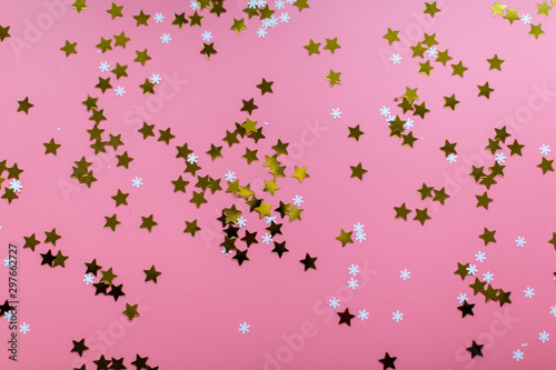 Stars and snowflakes on a pink background, from above - 297662727