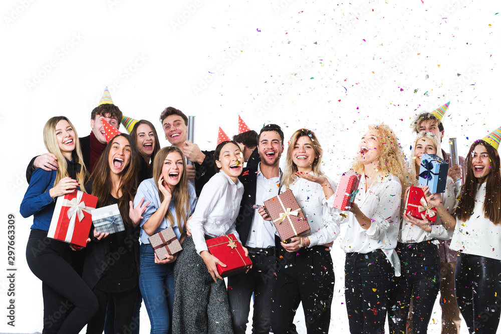 Fototapety, obrazy: Beautiful people having fun on a white background. Concept celebrating New Year or Christmas.