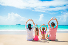 Happy Family On The Beach Duri...