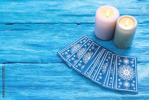 Blue tarot cards deck on blue wooden table background. Canvas Print