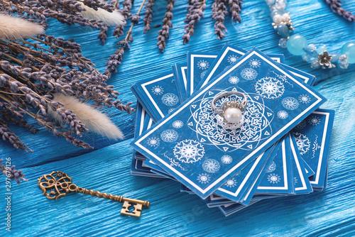Obraz na płótnie Blue tarot cards deck on blue wooden table background.