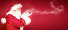 Real Santa Claus On Red Studio Background.