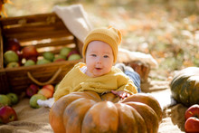 Cute Little Girl Sitting On Pu...