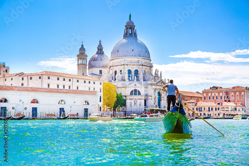 Tablou Canvas Gondolier and gondola on Grand Canal, Basilica Santa Maria della Salute in Venice, Italy