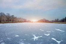 The Sun Over A Frozen Lake On ...