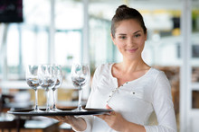 Waitress Holds Glasses On A Tray