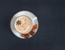 Indian Masala Chai Tea. Traditional Indian Hot Drink With Milk And Spices On Dark Stone Table Background. Top View, Flat Lay. Copy Space