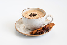 Indian Masala Chai Tea. Traditional Indian Hot Drink With Milk And Spices On White Concrete Background Closeup.