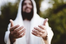 Biblical Scene - Of Jesus Christ Landing His Hands With A Blurred Background