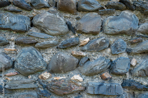 Texture of old rock wall for background, Medieval stone wall.