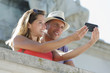 romantic couple during selfie outdoors