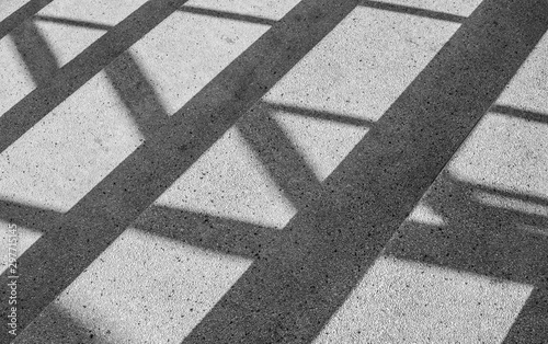 Obraz Architectural design of stair concrete with shadow looking at a mirage Black and white. - fototapety do salonu