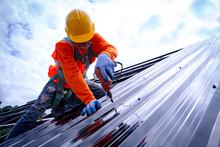 Roofer Working On Roof Structu...