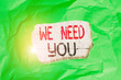 Leinwandbild Motiv Conceptual hand writing showing We Need You. Concept meaning to fulfill the needs of the assignment duty or obligation Green crumpled colored paper sheet torn colorful background