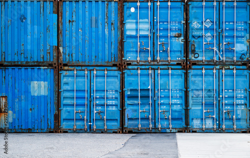 Foto op Plexiglas Schip ,Stack of blue containers in a harbour for background.blue cargo containers in port