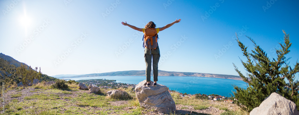 Fototapety, obrazy: Girl on the background of the sea and mountains.