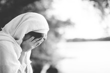 Closeup Shot Of A Female Wearing A Biblical Robe And Crying In Black And White