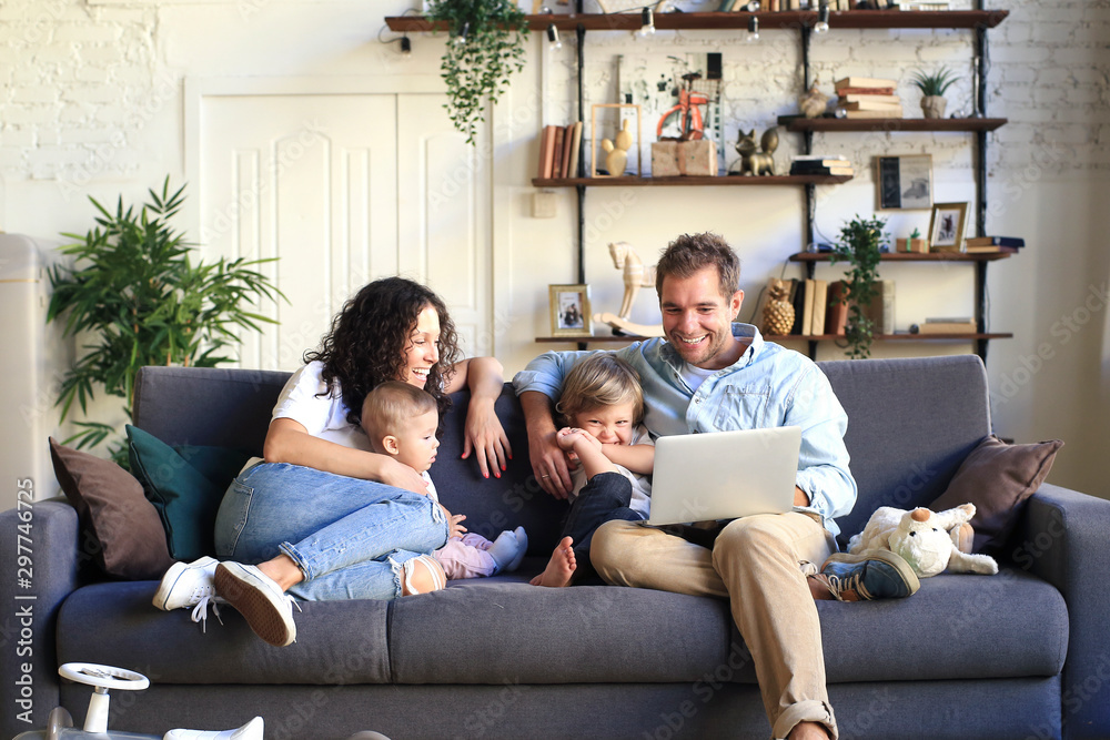 Fototapety, obrazy: Young beautiful happy family relaxing at home
