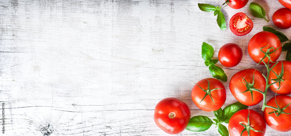 Fototapety, obrazy: Fresh ripe tomatoes on white background top view. Tomato red vegetable concept, copy space for text with basil leaves.