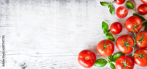 Foto Fresh ripe tomatoes on white background top view