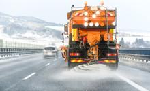 Snow Plow On Highway Salting Road. Orange Truck Deicing Street. Maintenance Winter Vehicle.