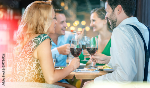Foto op Canvas Wild West People in a restaurant eating and drinking red wine