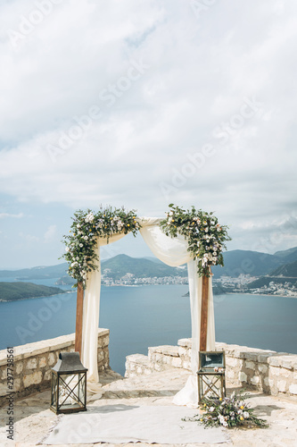Beautiful wedding arch with flowers on the background of the sea in Montenegro Canvas Print