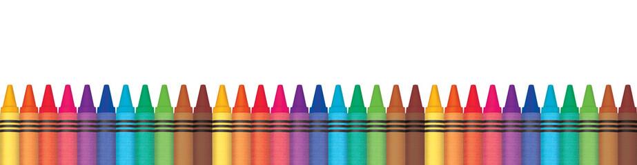 Rainbow wax crayons aligned...