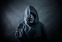 Ghostly Figure In Hooded Cloak...