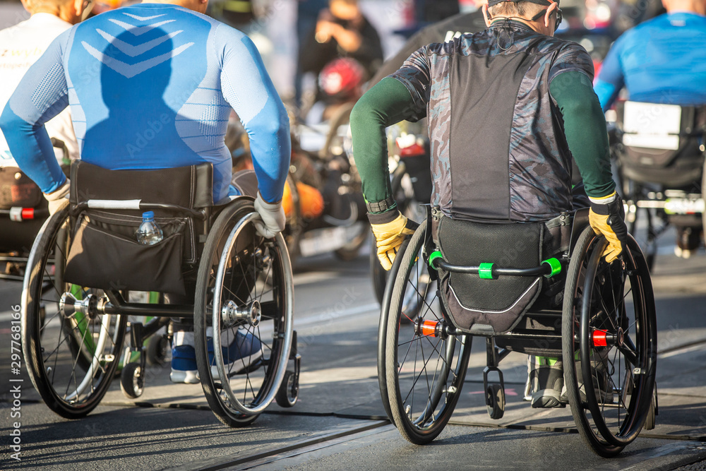 Fototapety, obrazy: Disabled athlete in a sport wheelchair during marathon run, disabled people professional sports.