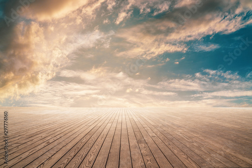 Recess Fitting Wood Empty wooden floor against cloudy sky with sunset.