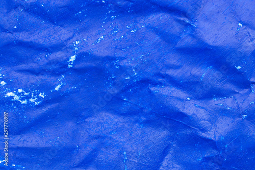 Fototapety, obrazy: Crumpled sheet of blue paper close-up.