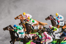 Galloping Jockeys And Race Hor...