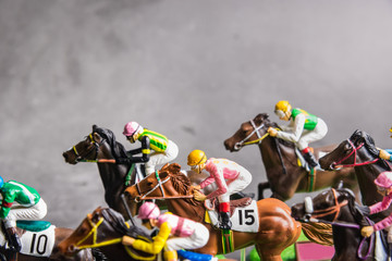 Galloping jockeys and race horses toy competing for position.Concept to compete for victory.