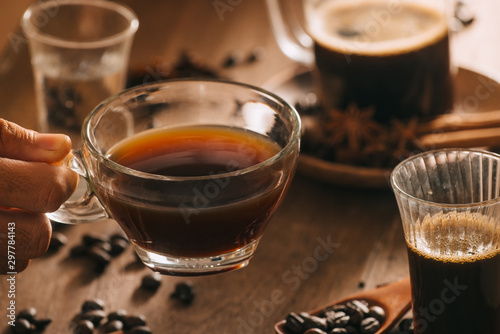 Wall Murals Cafe Cups of coffee with coffee beans on wooden background