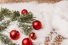 Christmas Bauble On Snowy Wooden Table. Christmas Concept