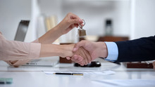 Woman Shaking Hands With Lawyer Holding House Keys, Successful Purchase, Deal