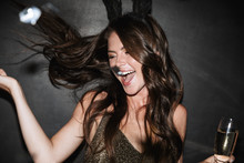 Image Of Laughing Woman Holdin...