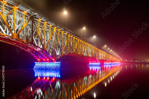 Valokuvatapetti Road-railway bridge over the Vistula (Wisla) river in Plock, Poland illuminated