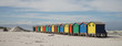 canvas print picture - Colorful Beach Huts at Muizenberg Beach along the Garden Route near Cape Town, South Africa.